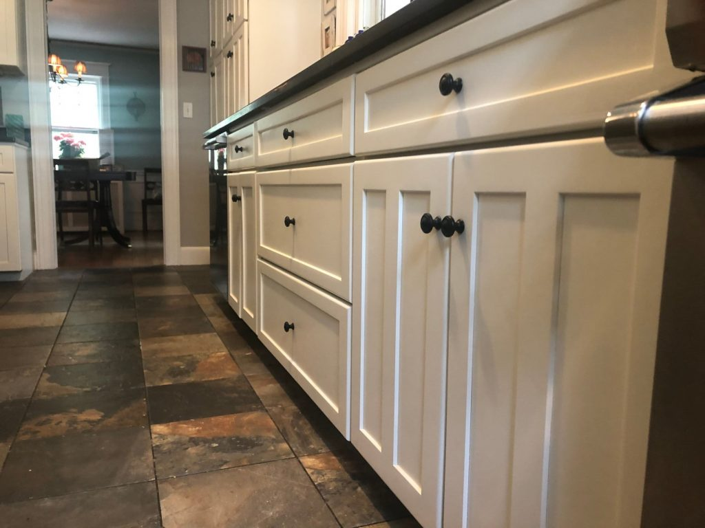 white kitchen cabinets with black knobs