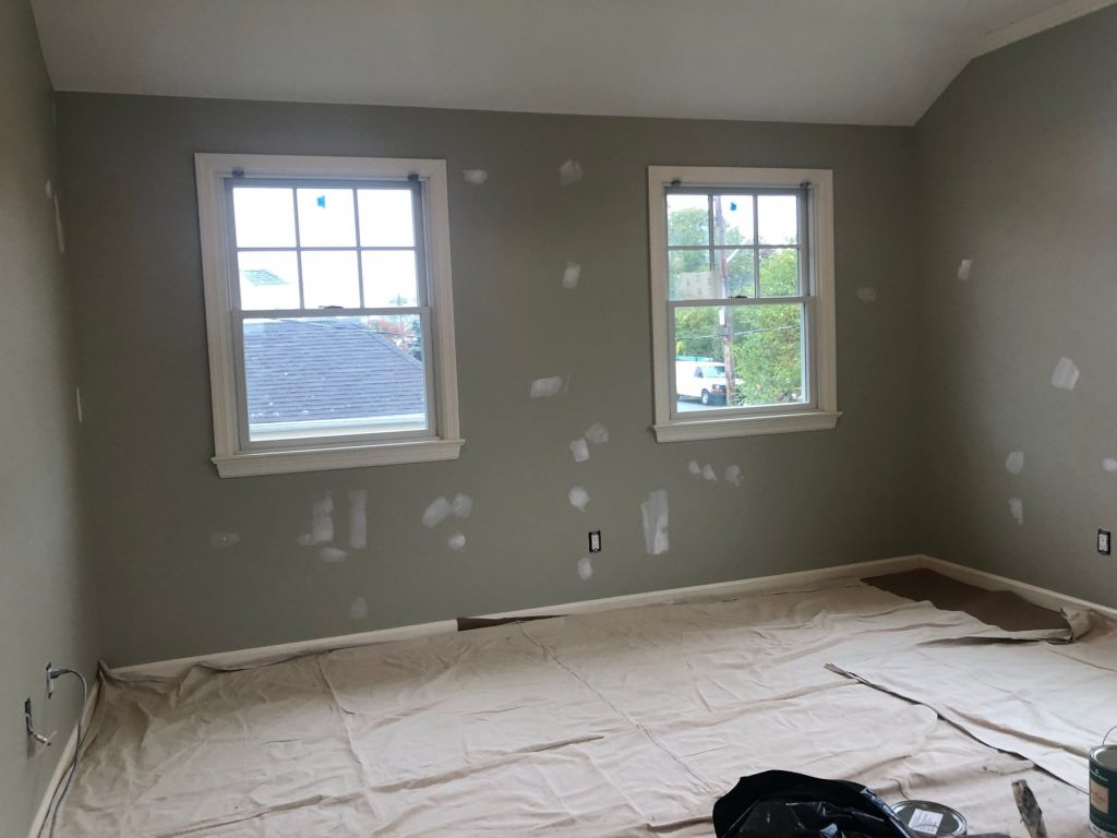 green walls with patches for painting prep
