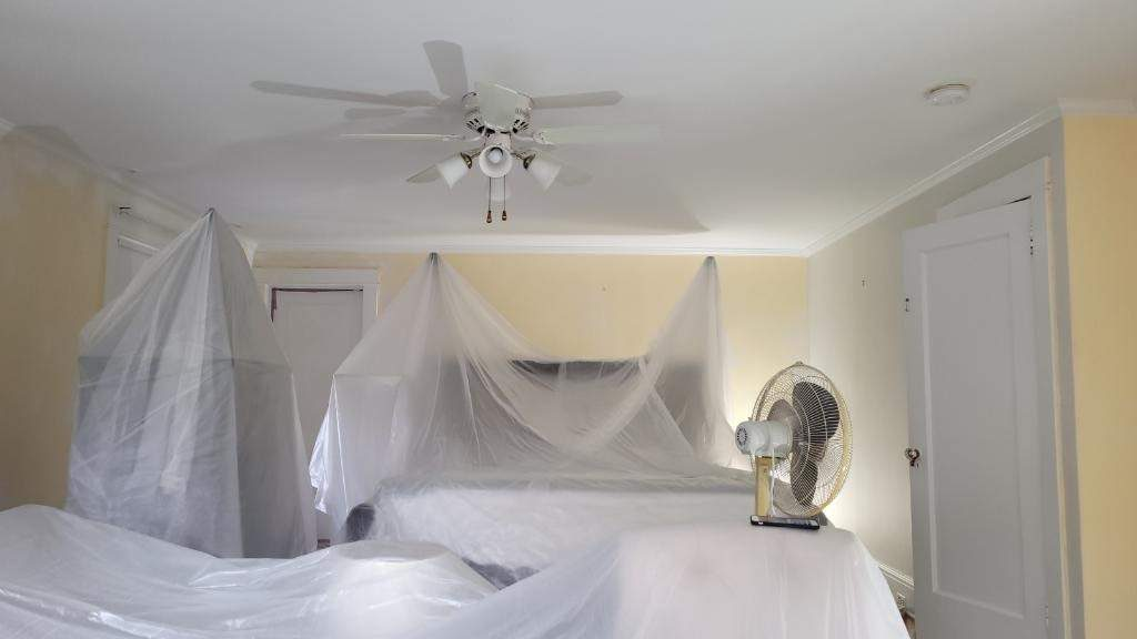 room draped in plastic ready for painting