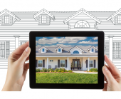blueprint drawing of house with house shown in an ipad